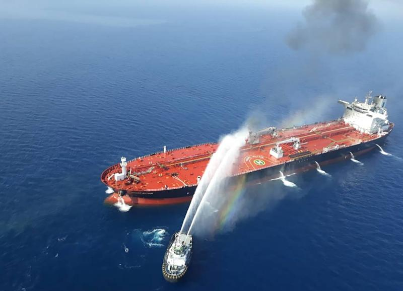 TOPSHOT - A picture obtained by AFP from Iranian news agency Tasnim on June 13, 2019 reportedly shows an Iranian navy boat trying to control fire from Norwegian owned Front Altair tanker said to have been attacked in the waters of the Gulf of Oman. - Suspected attacks left two tankers in flames in the waters of the Gulf of Oman today, sending world oil prices soaring as Iran helped rescue stricken crew members. The mystery incident, the second involving shipping in the strategic sea lane in only a few weeks, came amid spiralling tensions between Tehran and Washington, which has pointed the finger at Iran over earlier tanker attacks in May. Subject : IRAN OIL TANKER 5 (Photo by - / TASNIM NEWS / AFP)-/AFP/Getty Images ORIG FILE ID: AFP_1HH6NY