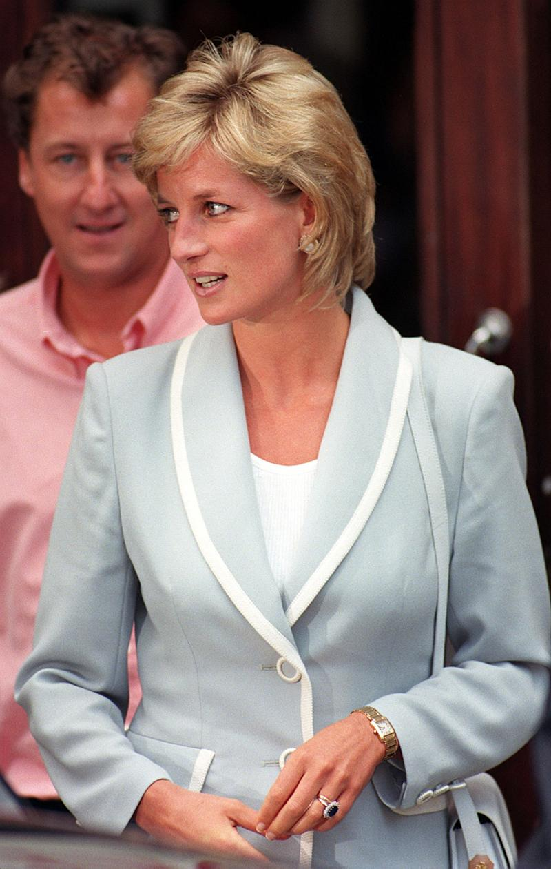 Diana, Princess of Wales, wearing her diamond and sapphire engagement ring and wedding ring, as she leaves the studios of the English National Ballet following a lunch today (Weds), on the day that her marriage to the Prince of Wales officially came to an end with the issue of the decree absolute. See PA Story ROYAL Divorce. Photo by David Cheskin.