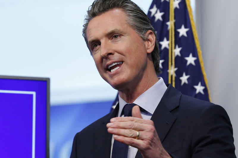 FILE - In this Tuesday, April 14, 2020, file photo California Gov. Gavin Newsom speaks during a news conference at the Governor's Office of Emergency Services in Rancho Cordova, Calif. A coalition of marijuana companies, churches and advocacy groups is asking Newsom for a temporary cut in the state's hefty pot taxes. The group that includes the California State Conference of the NAACP, Los Angeles Metropolitan Churches and the industry group Southern California Coalition warned in a letter to the governor that the coronavirus crisis and a crashing economy will take an especially heavy toll on businesses run by minorities who were disproportionately targeted during the decades-long drug war. (AP Photo/Rich Pedroncelli, Pool, File)