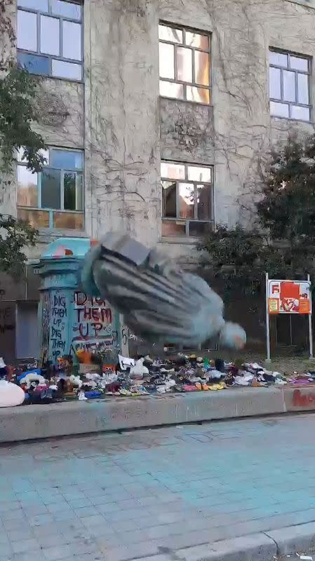 Video grab of the defaced statue of Egerton Ryerson, considered an architect of Canada's residential indigenous school system, being pulled to the pavement following a protest at Ryerson University in Toronto
