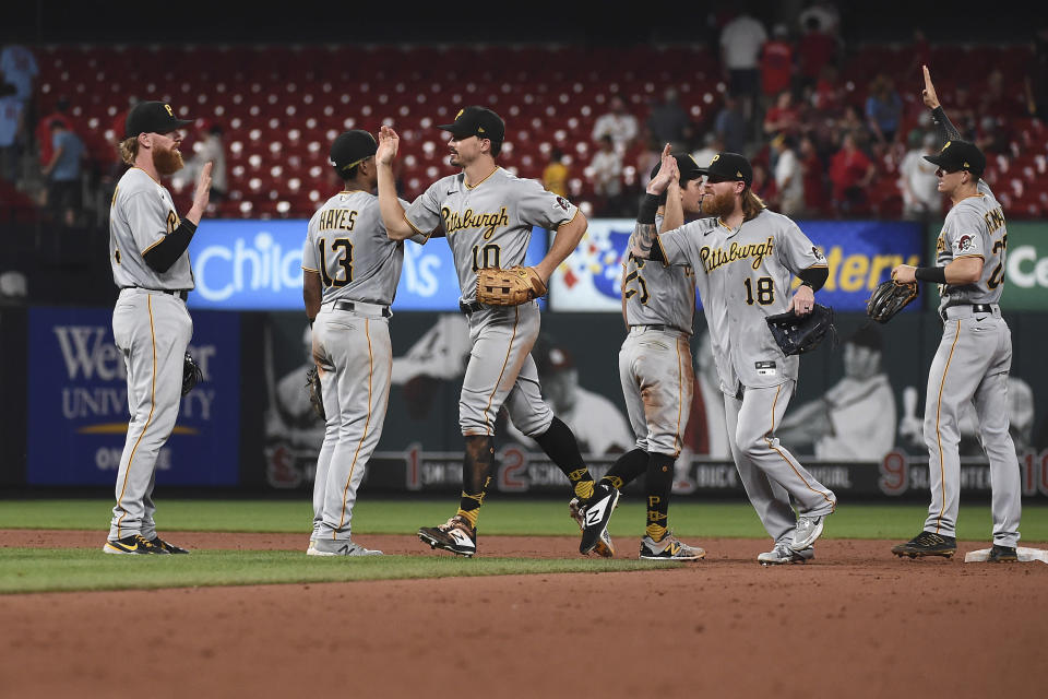 Members of the Pittsburgh Pirates celebrate after beating the St. Louis Cardinals in a baseball game Thursday, June 24, 2021, in St. Louis. (AP Photo/Joe Puetz)