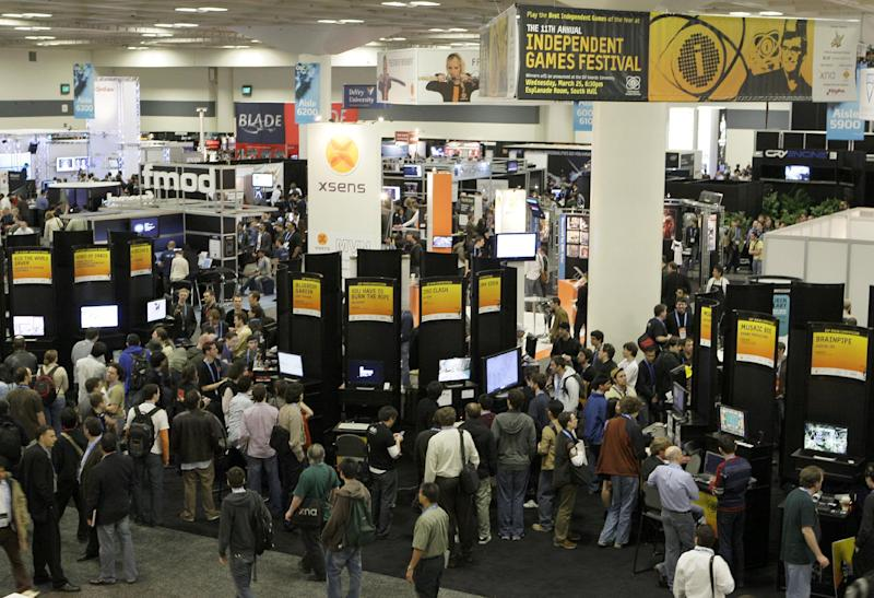 "FILE - In this March 25, 2009 file photo, Video game enthusiasts attend the Game Developers Conference, in San Francisco. The schedule for the 2013 GDC held March 25-29, illustrates the dramatic changes that have reshaped the gaming industry in recent years, an evolution that's as much about business models as it is about pixels. GDC organizers have added a summit on free-to-play games, planned talks on topics like crowd funding and micro-transactions and coordinated panels with such titles as ""Making Money with Mobile Gaming"" and ""Why Won't FarmVille Go Away?"" (AP Photo/Ben Margo, Filet)"