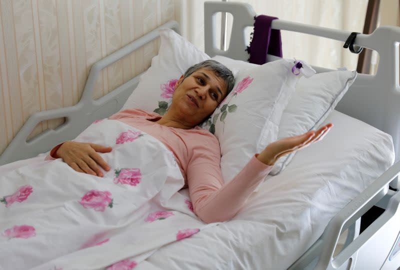 FILE PHOTO: Leyla Guven, pro-Kurdish Peoples' Democratic Party (HDP) lawmaker who has been on a hunger strike for more than four months, gestures as she rests in her bed at her home in Diyarbakir