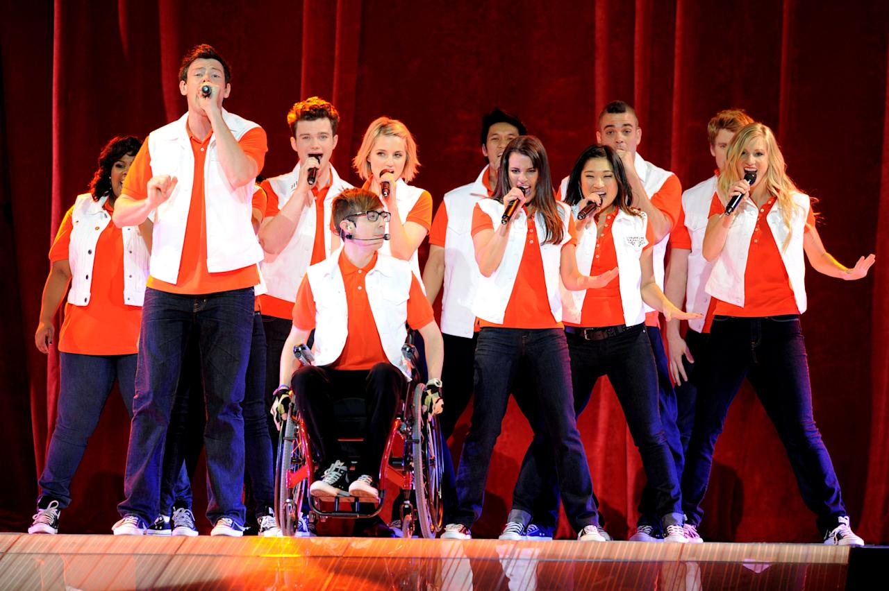 LOS ANGELES, CA - MAY 28:  (L-R) Actors/singers Amber Riley, Cory Monteith, Chris Colfer, Kevin McHale, Dianna Agron, Harry Shum Jr., Lea Michele, Jenna Ushkowitz, Mark Salling, Chord Overstreet and Heather Morris perform at Glee Live! at the Staples Center on May 28, 2011 in Los Angeles, California.  (Photo by Kevin Winter/Getty Images)