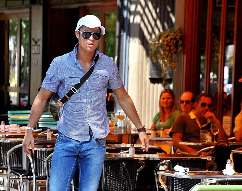 "Another athlete with a surprise announcement? Portuguese footballer Cristiano Ronaldo, spotted out in NYC Monday, revealed he is the proud father of a new baby boy, Cristiano Jr., who will be raised under the exclusive guardianship of the 25-year-old soccer stud. James Devaney/<a href=""http://www.wireimage.com"" target=""new"">WireImage.com</a> - July 5, 2010"