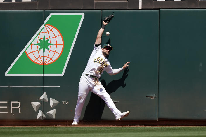 Oakland Athletics left fielder Seth Brown (15) cannot make the catch on a double by Cleveland Indians' Cesar Hernandez during the fifth inning of a baseball game Saturday, July 17, 2021, in Oakland, Calif. (AP Photo/Tony Avelar)