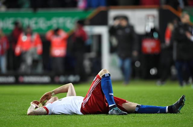 Soccer Football - Bundesliga - Werder Bremen vs Hamburger SV - Weser-Stadion, Bremen, Germany - February 24, 2018 Hamburg's Andre Hahn looks dejected at the end of the match REUTERS/Fabian Bimmer DFL RULES TO LIMIT THE ONLINE USAGE DURING MATCH TIME TO 15 PICTURES PER GAME. IMAGE SEQUENCES TO SIMULATE VIDEO IS NOT ALLOWED AT ANY TIME. FOR FURTHER QUERIES PLEASE CONTACT DFL DIRECTLY AT + 49 69 650050
