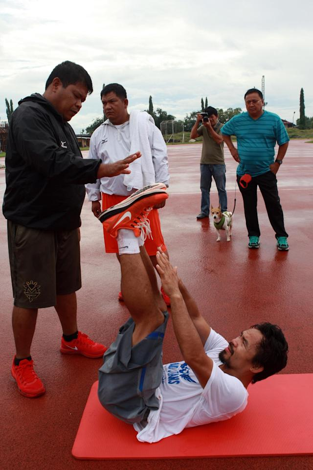 GENERAL SANTOS, PHILIPPINES - OCTOBER 08: Manny Pacquiao takes part in a training session on October 8, 2013 in General Santos, Philippines. Pacquiao will fight against Brandon Rios on November 23rd. (Photo by Jeoffrey Maitem/Getty Images)
