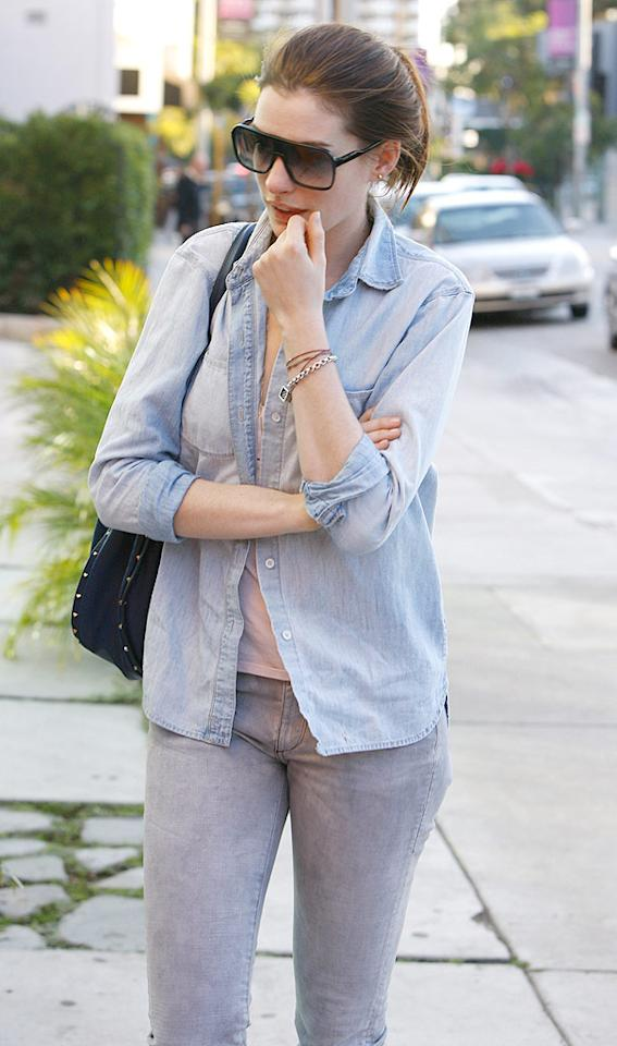 "In Los Angeles on Wednesday, Anne Hathaway wasn't having a great day. The actress was involved in a minor accident when the black Audi she was traveling in collided with a paparazzo on a bicycle. It doesn't appear that Hathaway's driver was at fault, and the pap suffered only minor injuries. ICE/<a href=""http://www.x17online.com"" target=""new"">X17 Online</a> - December 16, 2009"