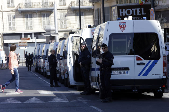 Police officers guard street during a protest in Nice, southeastern France, Saturday, March 23, 2019. The French government vowed to strengthen security as yellow vest protesters stage a 19th round of demonstrations, following last week's riots in Paris. (AP Photo/Claude Paris)