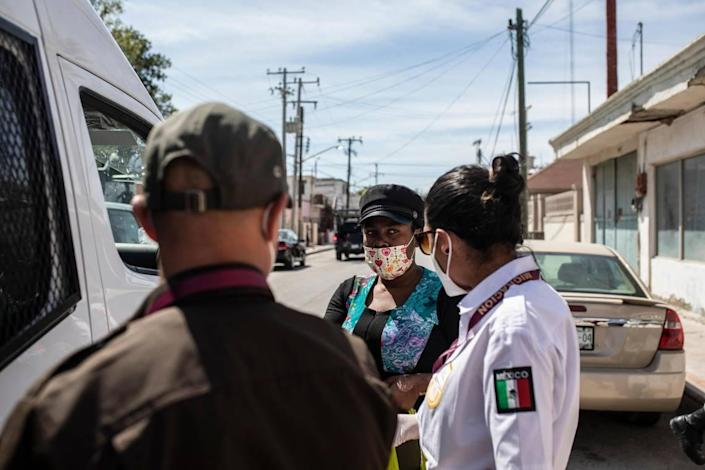 A migrant from Haiti is detained by Mexican immigration officers in Ciudad Acuña, Mexico, Wednesday, Sept. 22, 2021, near the Texas, U.S, border.