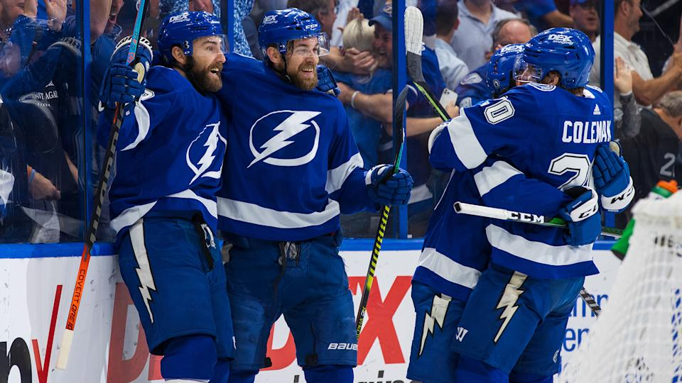 TAMPA, FL - JUNE 21: Yanni Gourde #37 of the Tampa Bay Lightning celebrates a goal with teammates Barclay Goodrow #19, Blake Coleman #20, and Jan Rutta #44 against the New York Islanders during the first period in Game Five of the Stanley Cup Semifinals of the 2021 Stanley Cup Playoffs at Amalie Arena on June 21, 2021 in Tampa, Florida. (Photo by Scott Audette/NHLI via Getty Images)