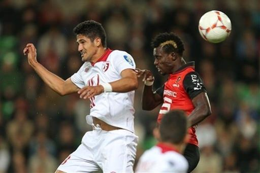Lille's forward Tulio De Melo of Brazil challenges for the ball with Rennes' defender John Boye during their french League One soccer match in Rennes, western France, Friday, Sept. 28, 2012. (AP Photo/David Vincent)