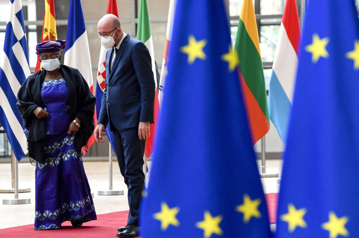 European Council President Charles Michel, right, speaks with Director-General of the World Trade Organization Ngozi Okonjo-Iweala prior to a meeting at the European Council building in Brussels, Wednesday, May 19, 2021. (John Thys, Pool via AP)