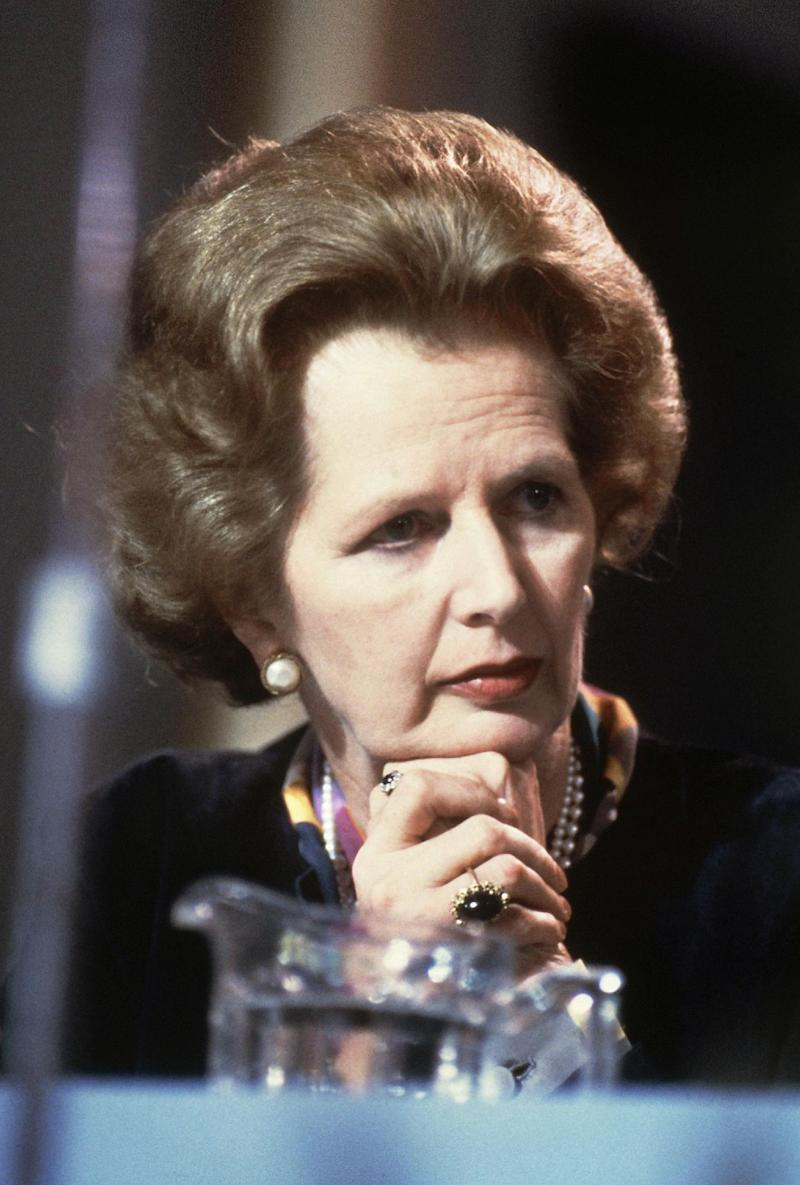 "FILE - British Prime Minister Margaret Thatcher listens to the opening debates during the Conservative Party's conference at Blackpool in this file photo dated October 1983.  Papers from 1981, released Saturday March 17, 2012, by the Margaret Thatcher archive at Cambridge University in England, reveal a thoughtful softer side to the British leader who earned her nickname ""The Iron Lady"", and also show something of the personal relationship between Margaret and her husband Denis. (AP Photo/David Caulkin, File)"