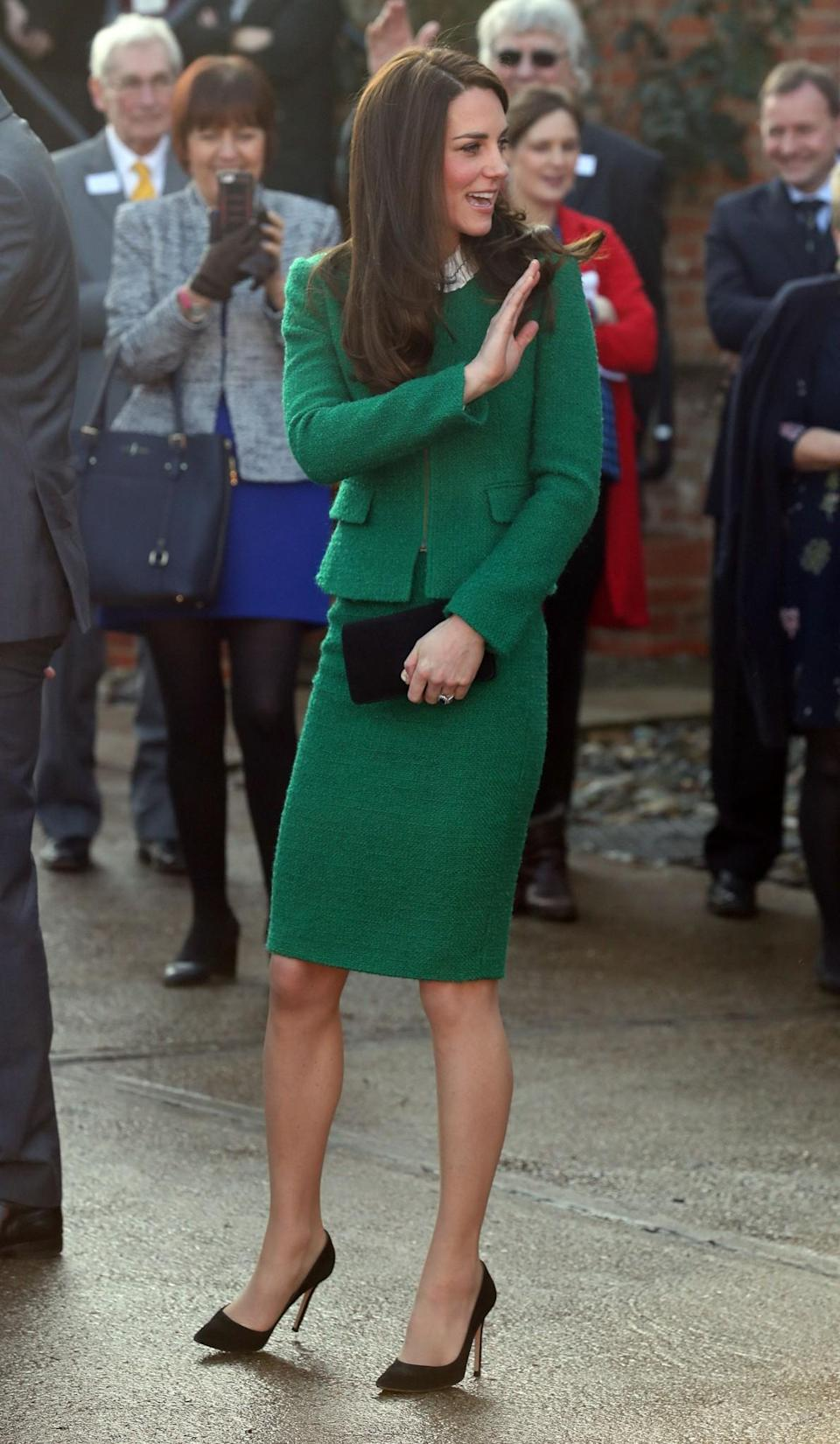 <p>The Duchess debuted a new skirt suit from high street retailer, Hobbs, while visiting a children's hospice in Norfolk. The emerald green style is made in an elegant tweed fabric and was paired with a simple white collared shirt and black heels.<br><i>[Photo: PA]</i> </p>
