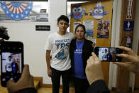 <p>U.S. citizen Benjamin Zepeda, 14, with his mother Lorena Zepeda, who benefits from Temporary Protected Status have their photo taken after a news conference in Los Angeles, Monday, Jan. 8, 2018. (Photo: Damian Dovarganes/AP) </p>