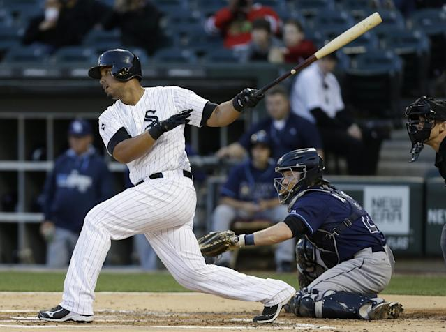 Chicago White Sox's Jose Abreu hits an one-run single during the first inning of a baseball game against the Tampa Bay Rays in Chicago on Friday, April 25, 2014. (AP Photo/Nam Y. Huh)
