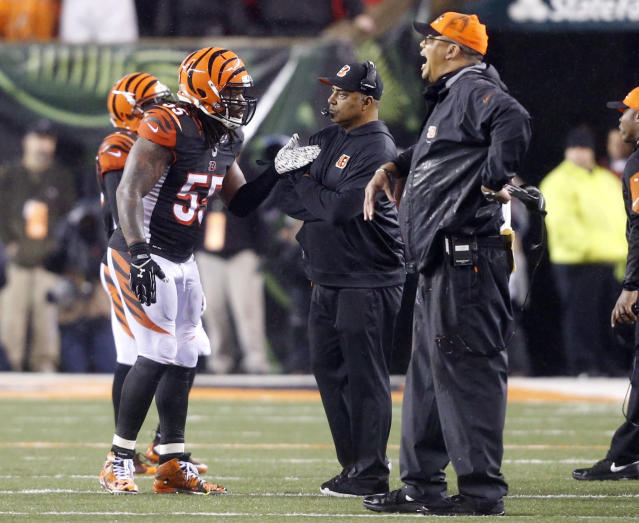 FILE - In this Jan. 10, 2016, file photo, Cincinnati Bengals head coach Marvin Lewis, center, talks with outside linebacker Vontaze Burfict (55) after a penalty during the second half of an NFL wild-card playoff football game against the Pittsburgh Steelers in Cincinnati. The Bengals had two 15-yard penalties that helped the Steelers win a playoff game at Paul Brown Stadium in the 2015 season. They set a club record with 173 yards in penalties as Pittsburgh rallied to pull another one out last December. The theme for this week: Keep cool when the Steelers come to town again. (AP Photo/Frank Victores, File)