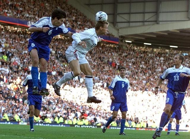 England's Teddy Sheringham scores against Greece to keep alive their hopes of topping Group Nine