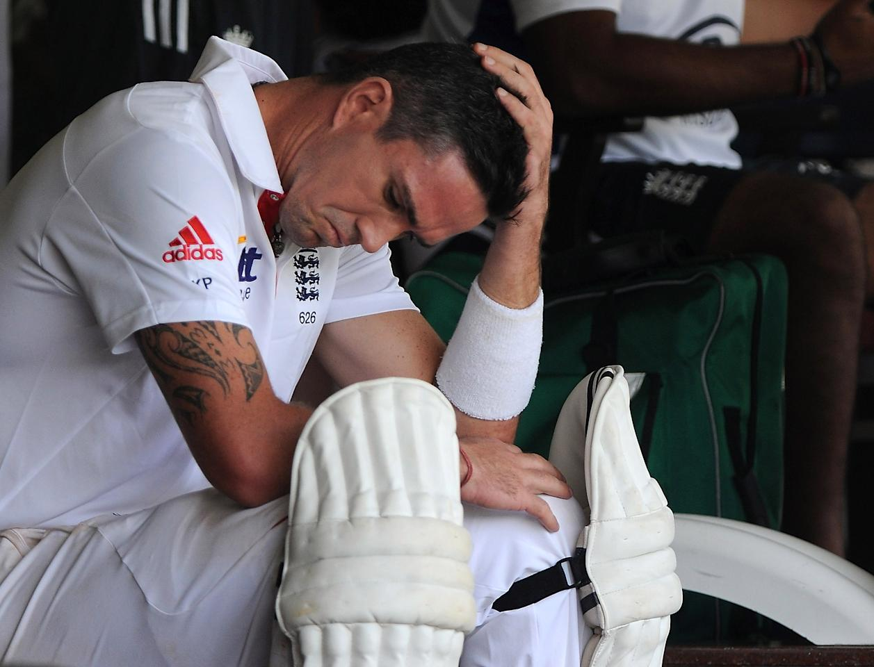 MUMBAI, INDIA - OCTOBER 31:  Kevin Pietersen of England sits outside the dressing room as he waits to bat during the second day of the first tour match between India A and England at the CCI (Cricket Club of India) Ground on October 31, 2012 in Mumbai, India.  (Photo by Pal Pillai/Getty Images)