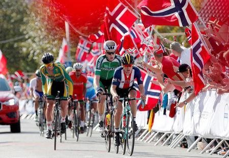 Cycling - UCI Road World Championships - Men Elite Road Race - Bergen, Norway - September 24, 2017 – Alexey Vermeulen of the U.S., Conor Dunne of Ireland and Willem Jakobus Smit of South Africa compete. NTB Scanpix/Cornelius Poppe via REUTERS