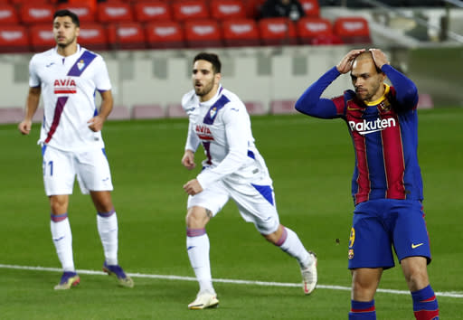 Barcelona's Martin Braithwaite reacts after missing to score from a penalty shot during the Spanish La Liga soccer match between Barcelona and Eibar at the Camp Nou stadium in Barcelona in Barcelona, Spain, Tuesday, Dec. 29, 2020. (AP Photo/Joan Monfort)