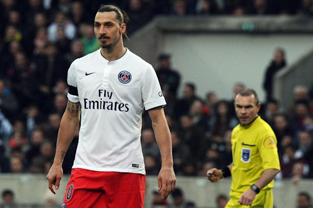 """Paris Saint-Germain's Swedish forward Zlatan Ibrahimovic (L) has defended himself for an outburst in which he labelled France a """"shit country"""" (AFP Photo/Nicolas Tucat)"""