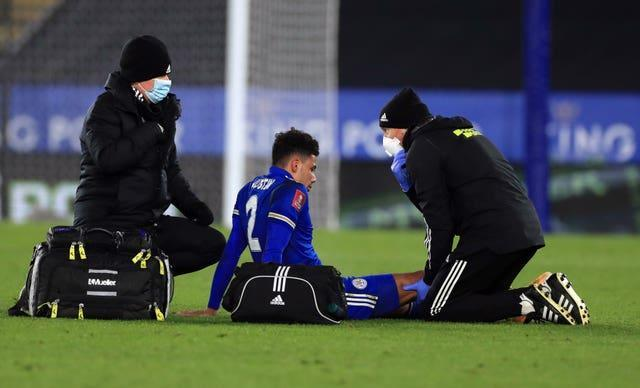 James Justin receives treatment for a knee injury