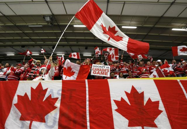 Canadian supporters before Canada plays Switzerland in their quarter-final IIHF World Junior Championship ice hockey game in Malmo, Sweden, January 2, 2014. REUTERS/Alexander Demianchuk (SWEDEN - Tags: SPORT ICE HOCKEY)