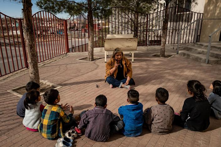 "Psychologist Patricia Galarza leads a group therapy session about how to say goodbye to your friends with the children living at the San Juan Apóstol migrant shelter. The children will soon be separated from each other as the government starts processing asylum seekers under MPP into the U.S.<span class=""copyright"">Meridith Kohut for TIME</span>"