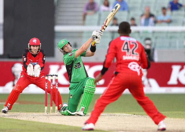 MELBOURNE, AUSTRALIA - JANUARY 06:  Cameron White of the Melbourne Stars hits a six against Marlon Samuels of the Melbourne Renegades during the Big Bash League match between the Melbourne Stars and the Melbourne Renegades at Melbourne Cricket Ground on January 6, 2013 in Melbourne, Australia.  (Photo by Michael Dodge/Getty Images)