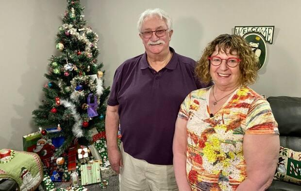 Russ and Marla Barr have kept their Christmas decorations up since last fall, with presents patiently waiting under the tree, until it was safe for their family to get together. (Bonnie Allen/CBC - image credit)