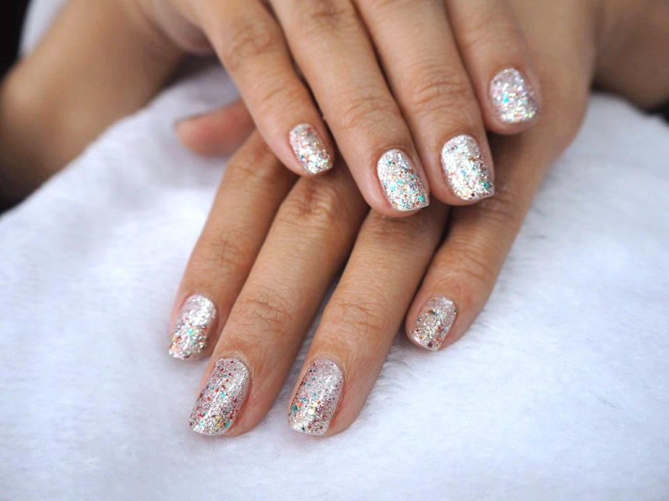 """<p>Make your nails even more exciting than a firework finale with tons of multi-colored glitter. Try creating an ombré effect by layering more glitter polish on toward the tips.</p><p><a class=""""link rapid-noclick-resp"""" href=""""https://www.amazon.com/Cirque-Colors-Glitter-Nail-Polish/dp/B00ITZTIW4/?tag=syn-yahoo-20&ascsubtag=%5Bartid%7C10055.g.1278%5Bsrc%7Cyahoo-us"""" rel=""""nofollow noopener"""" target=""""_blank"""" data-ylk=""""slk:SHOP GLITTER POLISH"""">SHOP GLITTER POLISH</a></p>"""
