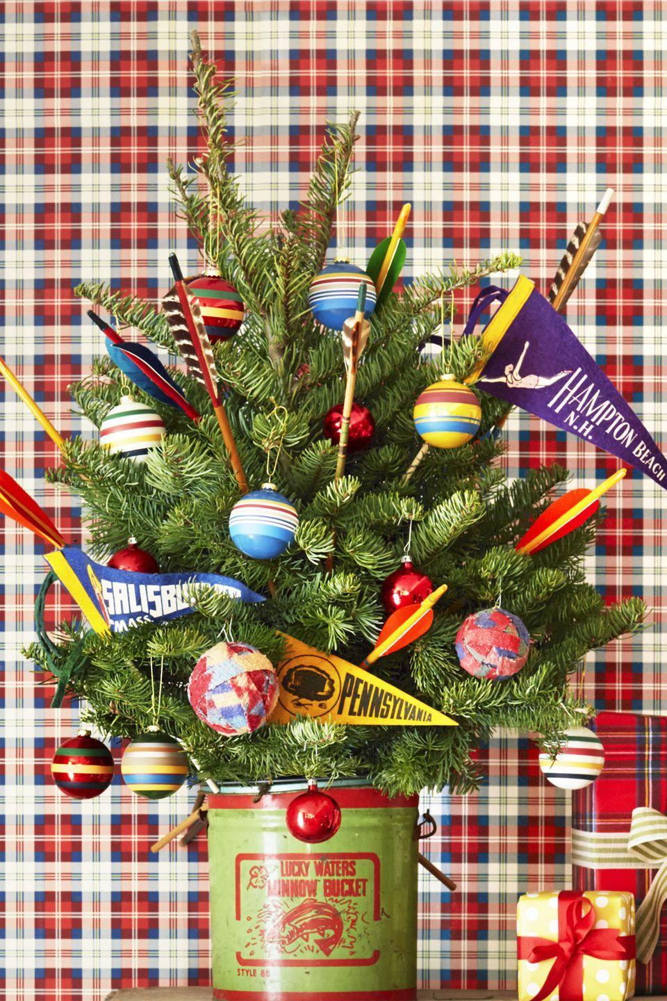 <p>Take your school pride to the next level by sticking mini pennant flags with the names of your kids' colleges or high schools in this small tree. </p>