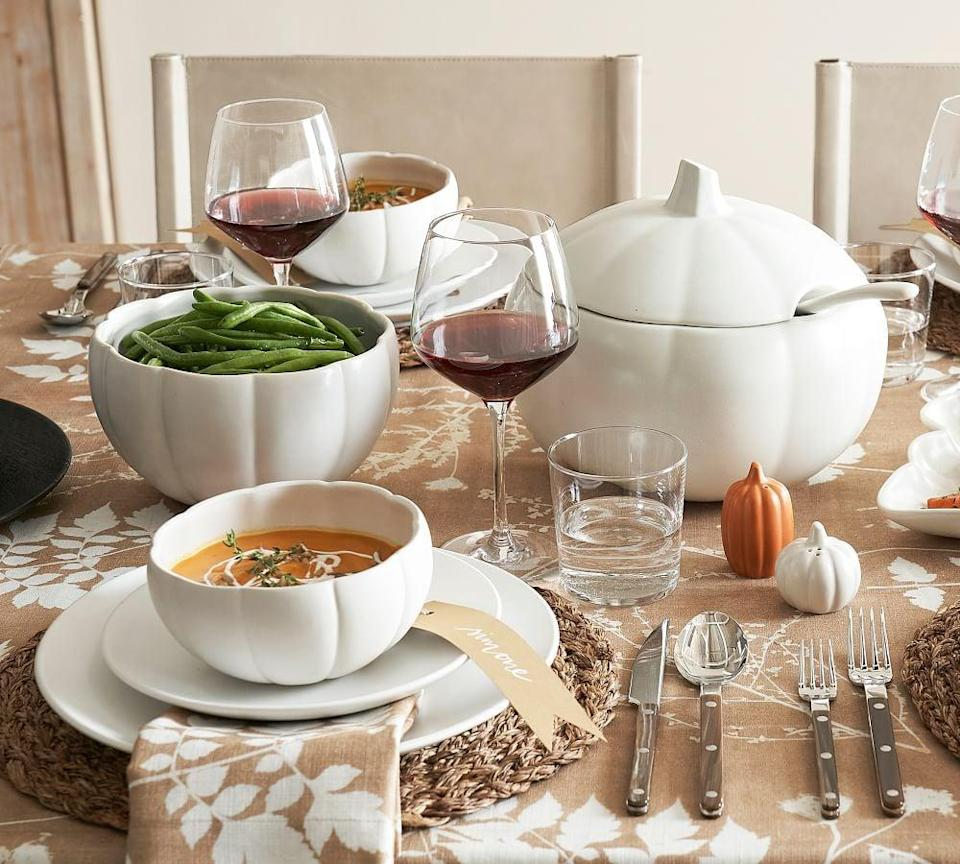 <p>Perfect for soups, veggies, and everything in between, this <span>Pottery Barn Modern Pumpkin Shaped Stoneware Serving Bowl</span> ($29) is a must.</p>