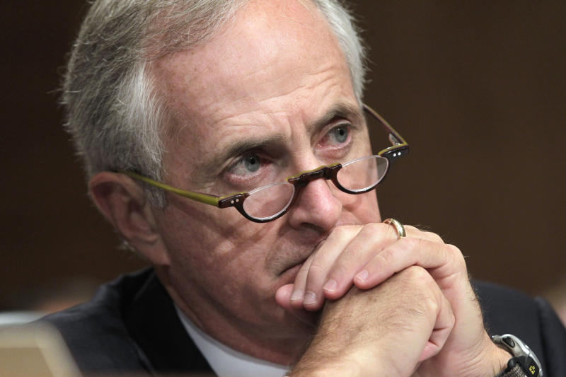FILE - This Oct. 6, 2011 file photo shows Senate Banking Committee member Sen. Bob Corker, R-Tenn. listening during a hearing on Capitol Hill in Washington. Corker is spending a lot of time lately talking to Democrats. The freshman lawmaker from Tennessee spoke briefly last week with Treasury Secretary Timothy Geithner after he unveiled his 10-year, $4.5 trillion solution to averting the end-of-year, double economic hit of tax hikes and automatic spending cuts. Deficit-cutting maven Erskine Bowles had forwarded Corker's proposal to White House Chief of Staff Jack Lew. (AP Photo/J. Scott Applewhite)