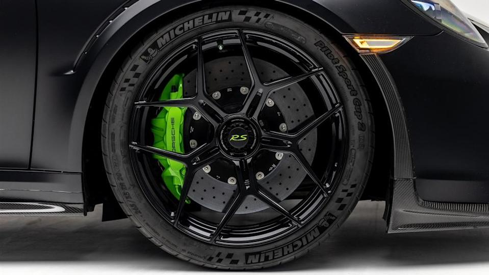 The car's central locking aluminum wheels feature an intricate web design from the owner and GMG.  - Credit: Photo by Ted Seven, courtesy of Global Motorsports Group.