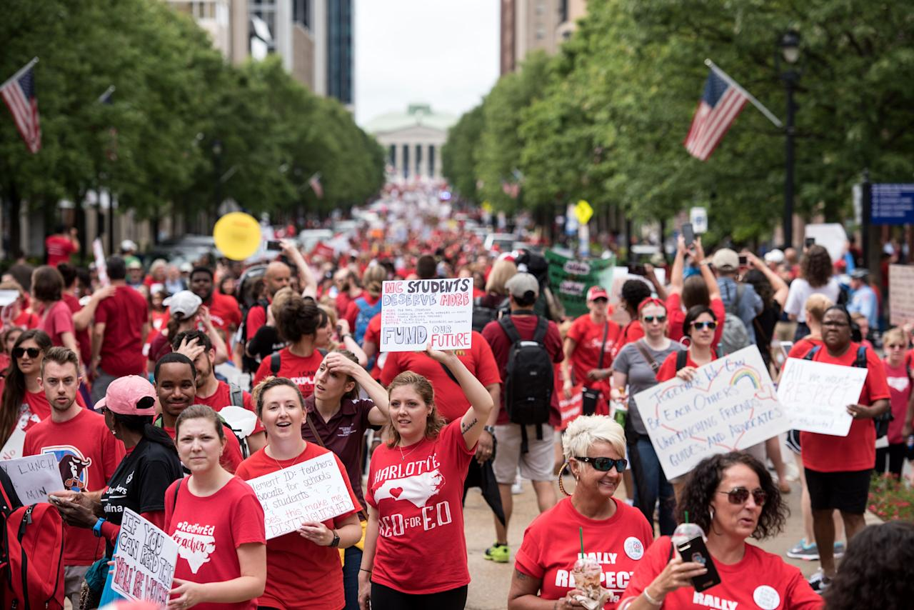 <p>Protesters gather in the streets during a North Carolina public school teacher march and rally in Raleigh, N.C., May 16, 2018. The teachers are asking for high salaries and more school funding from the North Carolina legislature. (Photo: Caitlin Penna/EPA-EFE/REX/Shutterstock) </p>