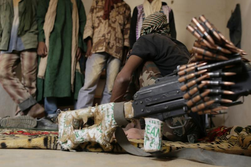 A soldier of the High Council for the Unity of Azawad sits in his quarters on July 27, in Kidal, northern Mali