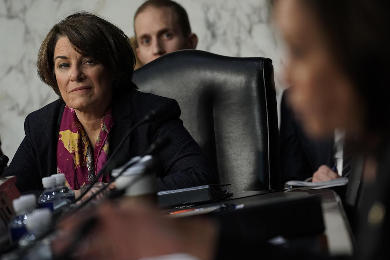 Sen. Amy Klobuchar listens to testimony during the confirmation hearing of William Barr. (Photo: Alex Wong/Getty)