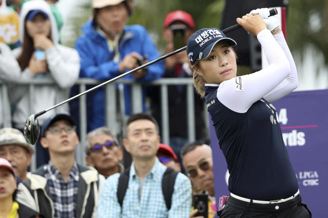 Hannah Green of Australia watches her tee shot on the first hole during the first round of the Taiwan Swinging Skirts LPGA at the Miramar Golf Country Club in New Taipei City, Taiwan, Thursday, Oct. 31, 2019. (AP Photo/Chiang Ying-ying)