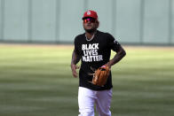"""St. Louis Cardinals' Carlos Martinez wears a """"Black Lives Matter"""" shirt during batting practice before a baseball game against the Pittsburgh Pirates Friday, July 24, 2020, in St. Louis. (AP Photo/Jeff Roberson)"""