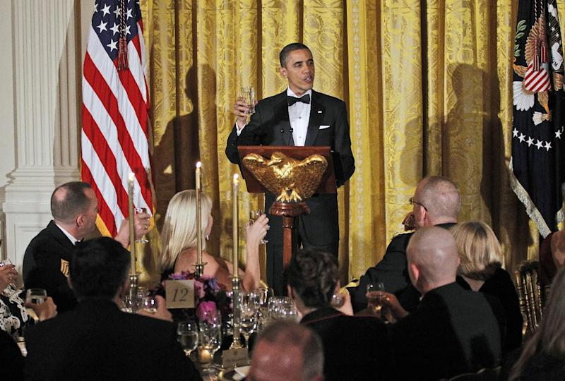President Barack Obama leads guests to a toast as he hosts a dinner for members of the U.S. military who served in Iraq in the East Room of the White House in Washington, Wednesday, Feb., 29, 2012. (AP Photo/Pablo Martinez Monsivais)