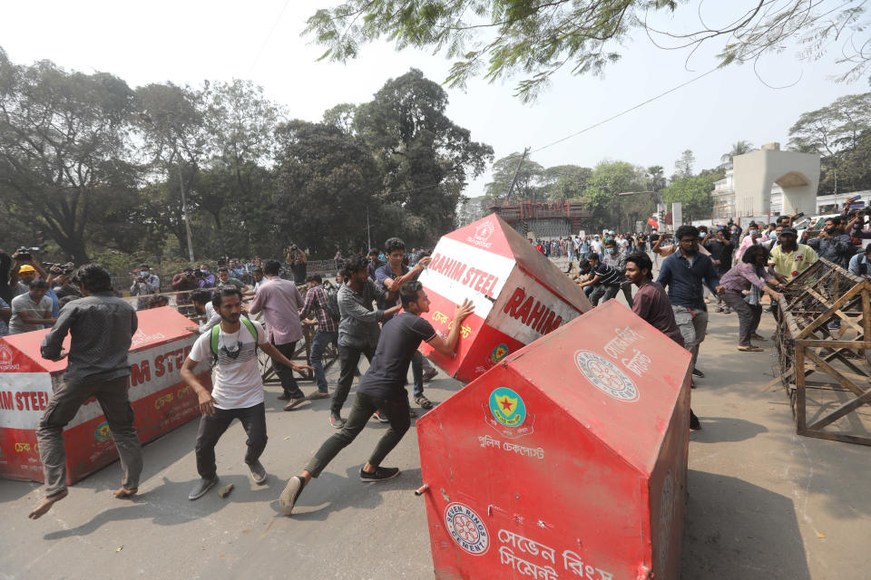 Bangladeshi students overturn security barricades outside the Home Ministry during a protest in Dhaka, Bangladesh, Monday, March 1, 2021. About 300 student activists rallied in Bangladesh's capital on Monday to denounce the death in prison of Mushtaq Ahmed, a writer and commentator who was arrested last year on charges of violating a sweeping digital security law that critics say chokes freedom of expression. (AP Photo/Mahmud Hossain Opu)