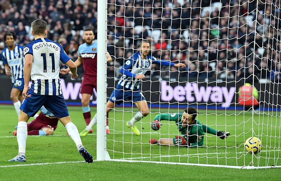 West Ham United's Polish goalkeeper Lukasz Fabianski (R) reacts as Brighton's English striker Glenn Murray scores his team's third goal during the English Premier League football match between West Ham United and Brighton and Hove Albion at The London Stadium, in east London on February 1, 2020. (Photo by Glyn KIRK / AFP) / RESTRICTED TO EDITORIAL USE. No use with unauthorized audio, video, data, fixture lists, club/league logos or 'live' services. Online in-match use limited to 120 images. An additional 40 images may be used in extra time. No video emulation. Social media in-match use limited to 120 images. An additional 40 images may be used in extra time. No use in betting publications, games or single club/league/player publications. /  (Photo by GLYN KIRK/AFP via Getty Images)
