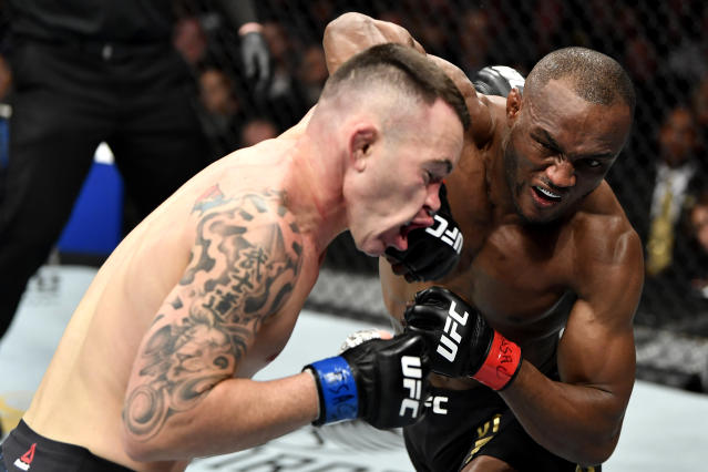 (R-L) Kamaru Usman strikes Colby Covington in their UFC welterweight championship bout during the UFC 245 event at T-Mobile Arena on Dec. 14, 2019 in Las Vegas. (Photo by Jeff Bottari/Zuffa LLC via Getty Images)