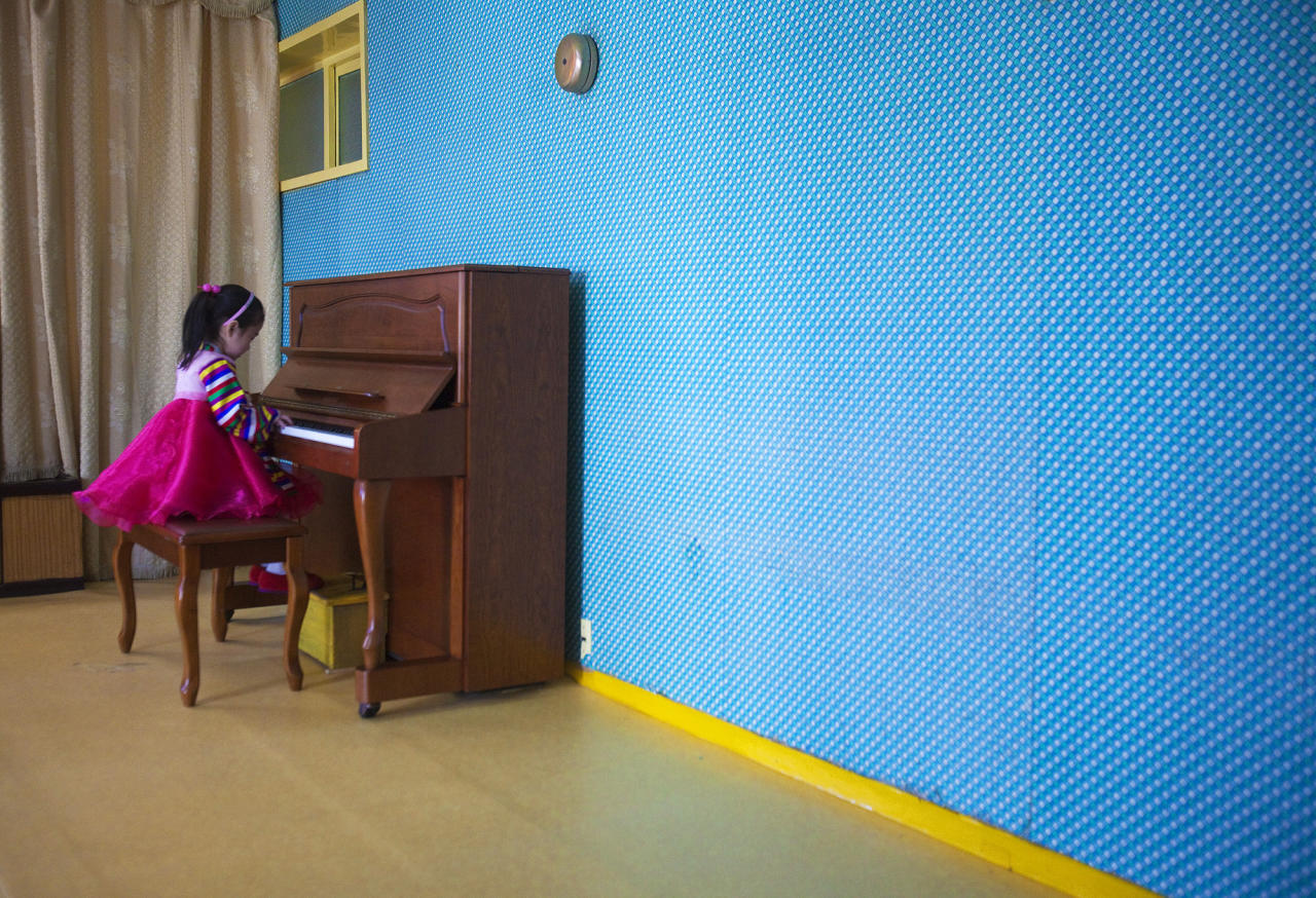 In this March 9, 2011 photo, a girl plays the piano inside the Changgwang Elementary School in Pyongyang, North Korea. (AP Photo/David Guttenfelder)