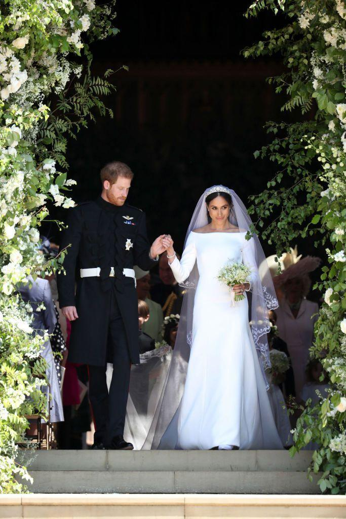 "<p><a href=""https://www.townandcountrymag.com/society/tradition/a13978425/meghan-markle-wedding-dress/"" rel=""nofollow noopener"" target=""_blank"" data-ylk=""slk:Meghan Markle wore a simple and elegant wedding dress"" class=""link rapid-noclick-resp"">Meghan Markle wore a simple and elegant wedding dress</a> designed by acclaimed British designer Clare Waight Keller for Givenchy. The dress featured a bateau neckline and three-quarter sleeves in a pure white color. <a href=""https://www.townandcountrymag.com/the-scene/weddings/g20686981/facts-about-meghan-markle-wedding-dress/"" rel=""nofollow noopener"" target=""_blank"" data-ylk=""slk:The bride's veil was a 16.5 foot"" class=""link rapid-noclick-resp"">The bride's veil was a 16.5 foot</a> hand-embroidered silk tulle creation, also made by Waight Keller and her team. </p>"