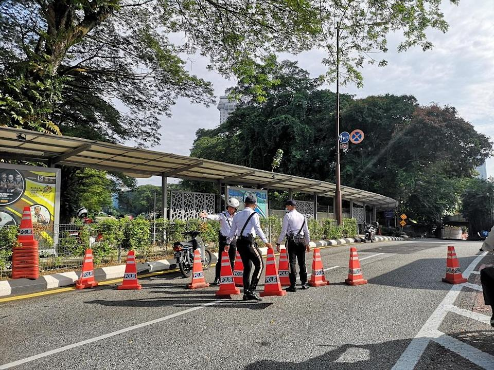 Police personnel set up a road block at the road leading to Dataran Merdeka in Kuala Lumpur July 31, 2021.